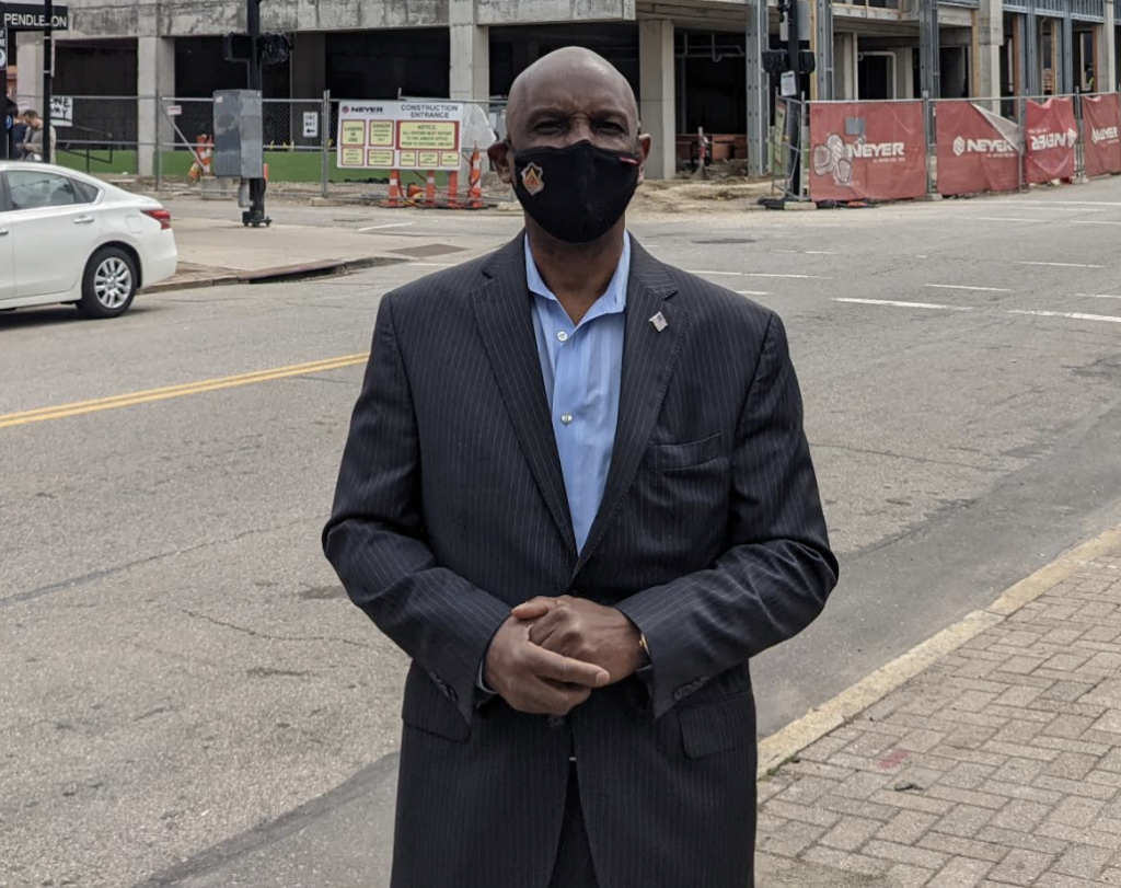 cecil thomas downtown wearing a mask